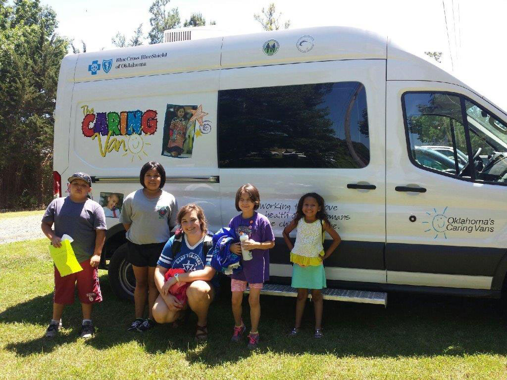 Children in front of the Caring Van.