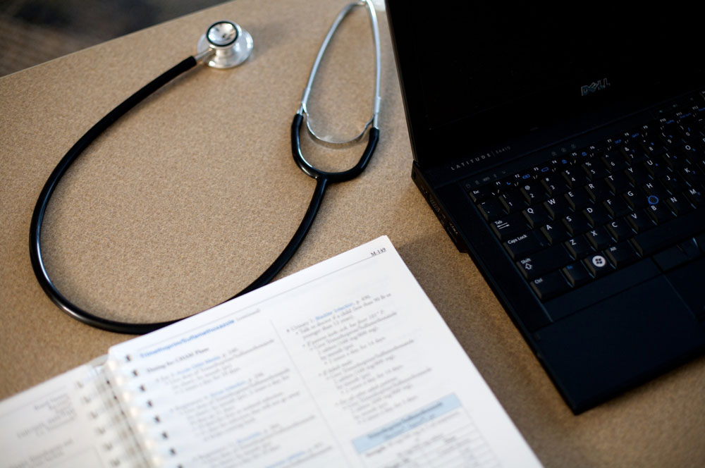 image of stethoscope, notepad, and computer